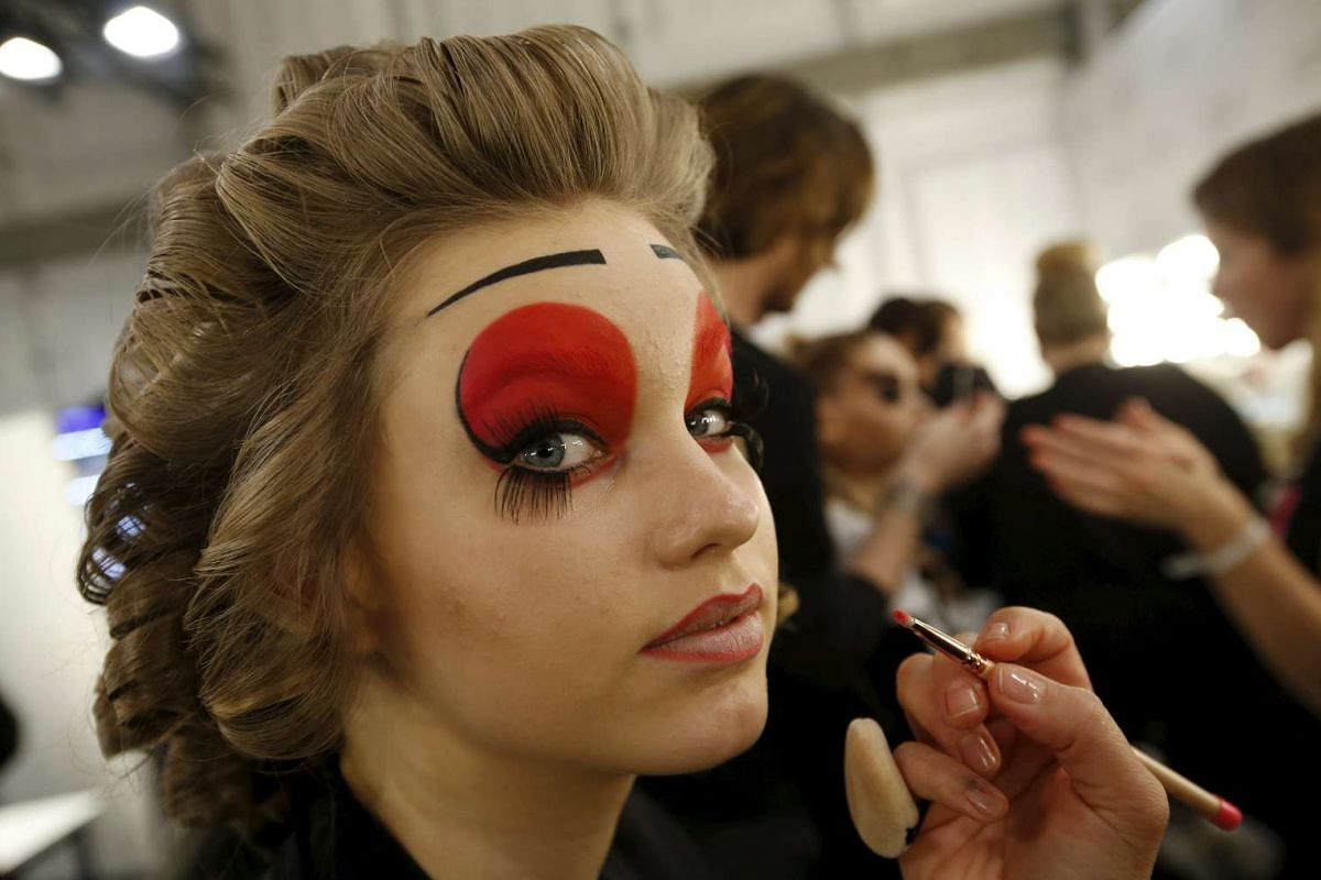 A model prepares backstage before a show by Maybelline New York on Jan 18, 2016.