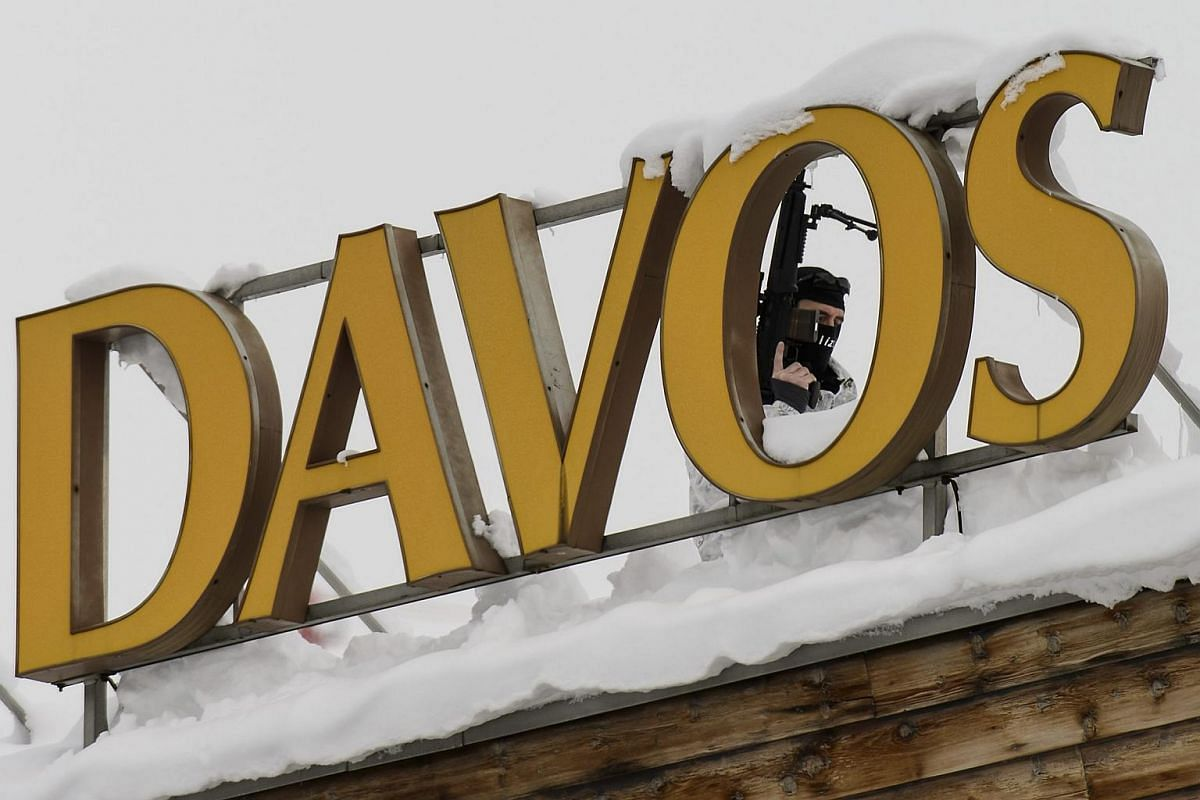 A member of the Swiss special police force stands on the roof of the Kongress Hotel next to the Congress Centre, ahead of the World Economic Forum (WEF) in Davos, Switzerland, on Jan 19, 2016.