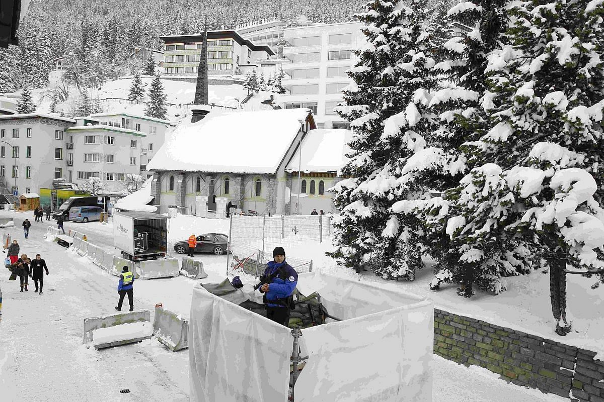 Swiss police officers control the area at the Davos Congress Centre ahead of the World Economic Forum (WEF) in Davos, Switzerland, on Jan 19, 2016.