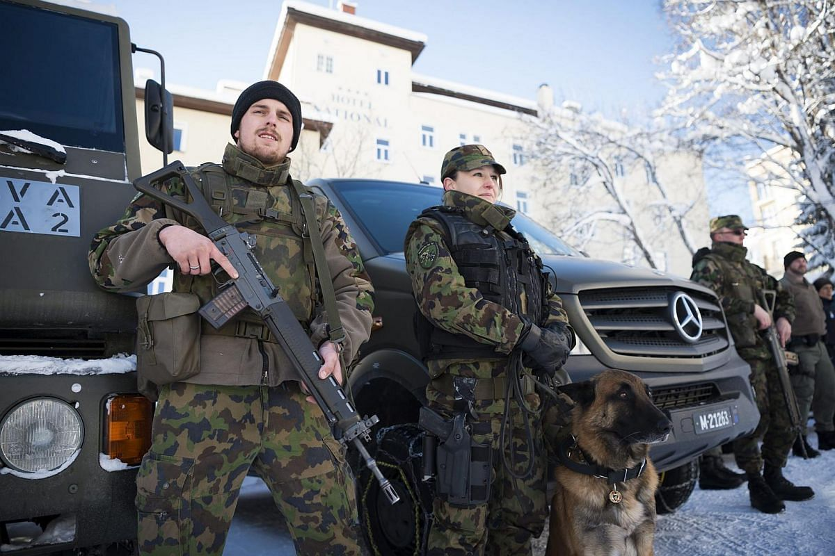 Swiss soldiers pose for a photograph after a press conference about security matters during the World Economic Forum (WEF), in Davos, Switzerland, on Jan 18, 2016.