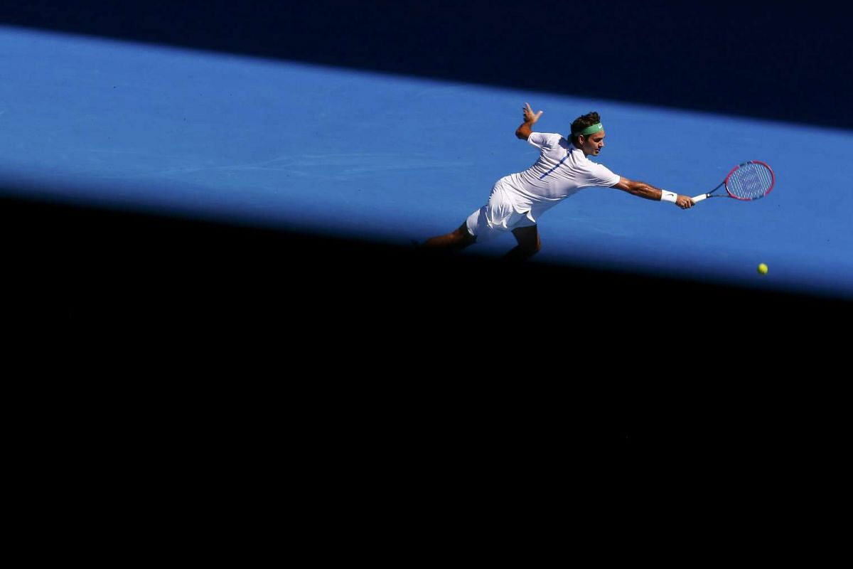 Switzerland's Roger Federer stretches for a shot during his second round match against Ukraine's Alexandr Dolgopolov at the Australian Open tennis tournament at Melbourne Park, Australia, Jan 20, 2016. PHOTO: REUTERS
