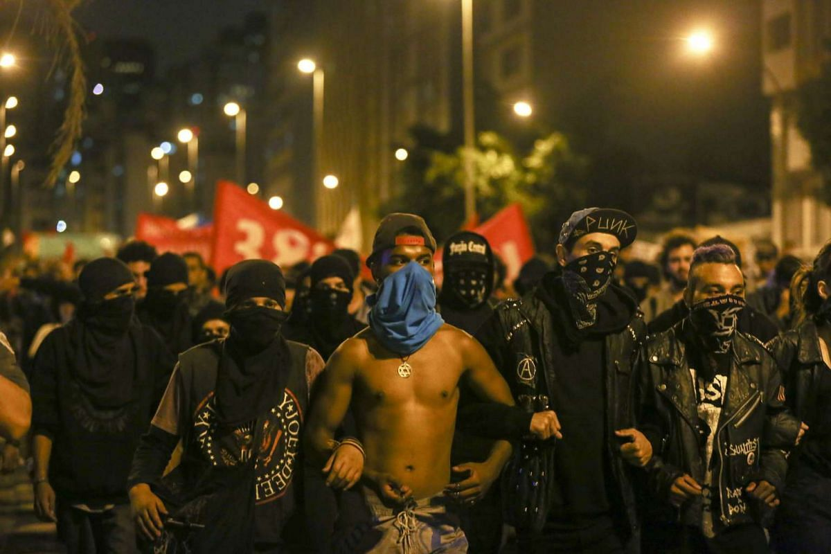 Hundreds of people march in protest against the raise of public transport fares in Sao Paulo, Brazil, on Jan 19, 2016. The march is the fourth called by the Free Fare Movement (MPL) during this year. PHOTO: EPA