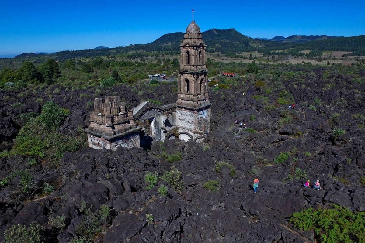 A photo made available on Jan 20, 2016, shows the church of San Juan Parangaricutiru in Angahuan, Michoacan State, Mexico, on Jan 17, 2016. The town of San Juan Parangaricutiru was destroyed in 1943 by an eruption of the Paricutin volcano. PHOTO: AFP