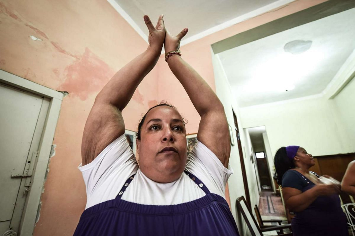 Members of the Danza Voluminosa Cuban dance group rehearsing at a private house in Havana.