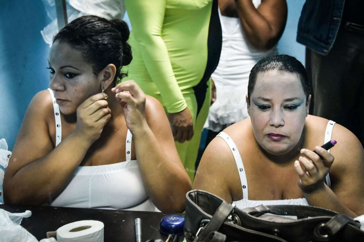 Members of the Danza Voluminosa putting on makeup in preparation for a rehearsal.
