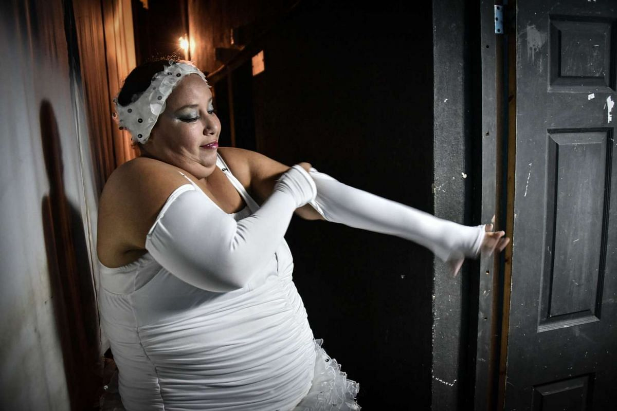 A member of the Danza Voluminosa Cuban dance group getting ready for a rehearsal.
