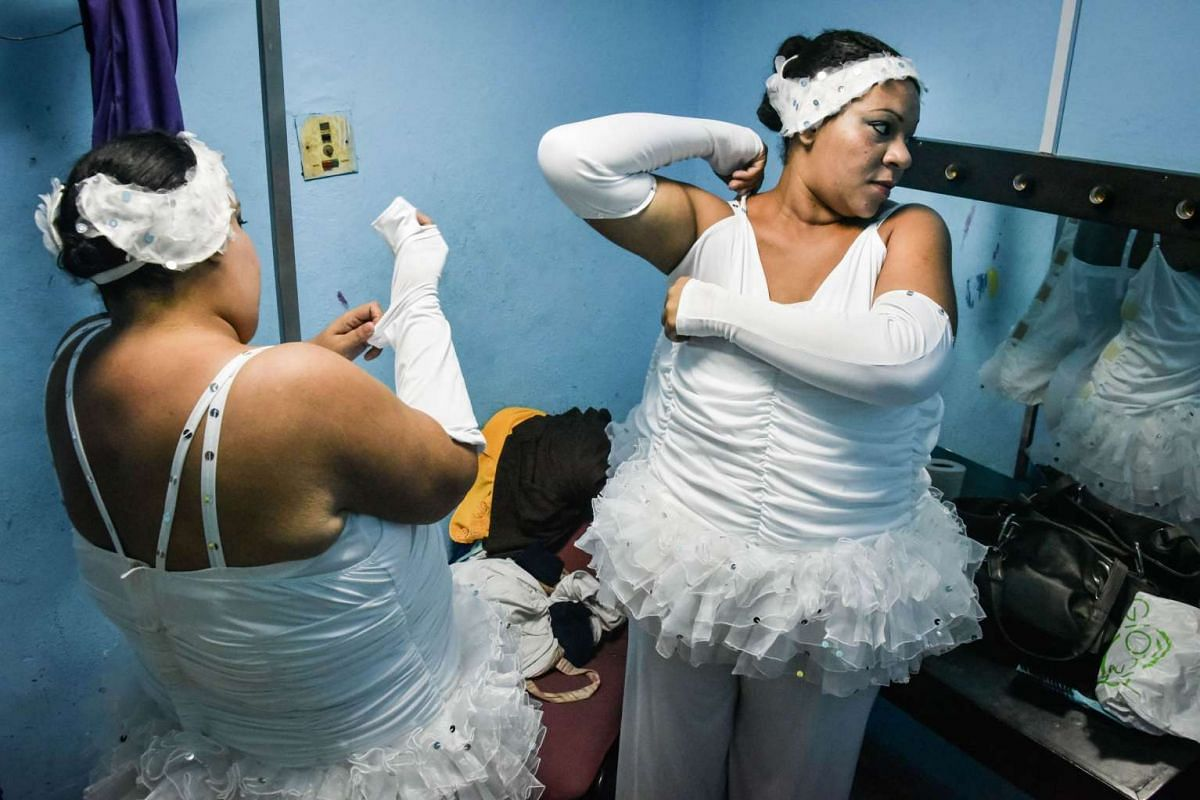 Members of the Danza Voluminosa Cuban dance group getting ready for a rehearsal.