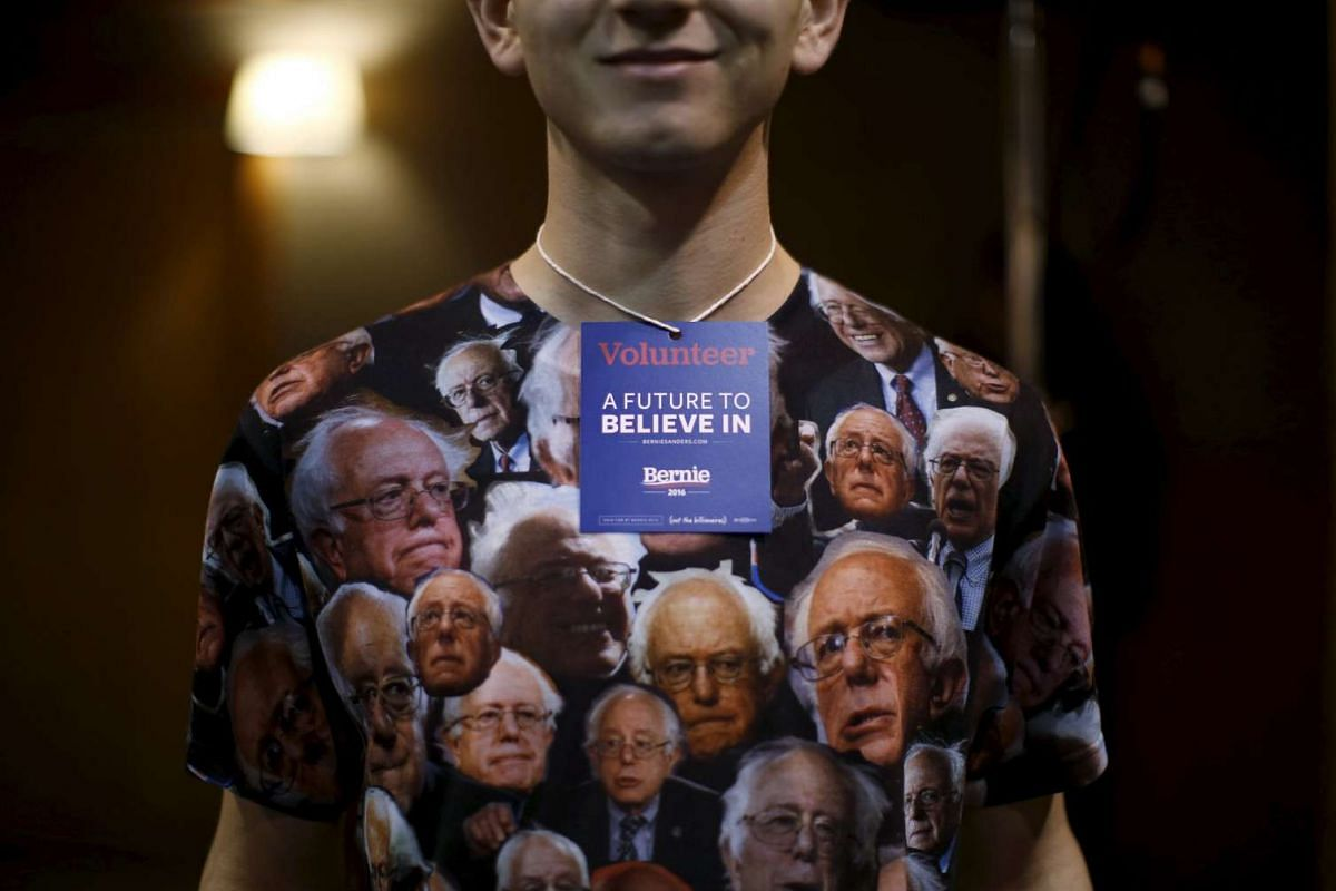 A volunteer at a campaign event for Democratic presidential candidate Bernie Sanders wears a shirt decorated with Mr Sanders' image in Fort Dodge, Iowa, United States, on Jan 19, 2016. PHOTO: REUTERS