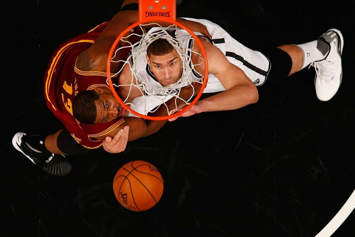 Brook Lopez #11 of the Brooklyn Nets battles Tristan Thompson #13 of the Cleveland Cavaliers for the ball during their game at the Barclays Centre on Jan 20, 2016, in New York City. PHOTO: GETTY IMAGES/AFP