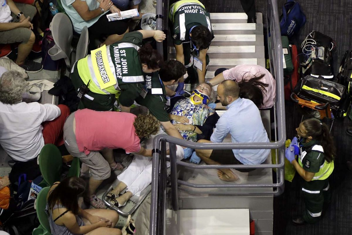 A woman is taken away by paramedics after tripping and falling down the stairs at Rod Laver Arena during the Australian Open tennis tournament in Melbourne, Australia, Jan 21, 2016. PHOTO: EPA