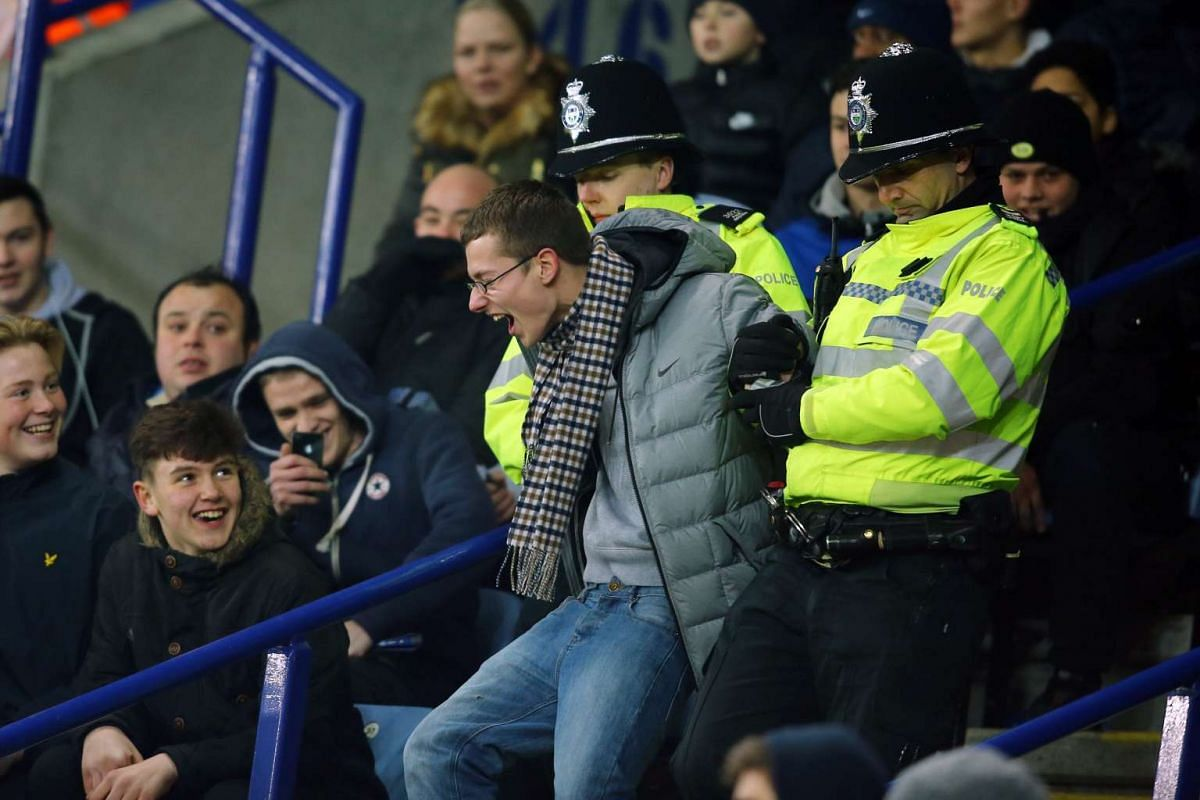 Police eject a Leicester City supporter, during the English FA Cup soccer match between Leicester City and Tottenham Hotspur at the King Power Stadium in Leicester, Britain, Jan 20, 2016. PHOTO: EPA