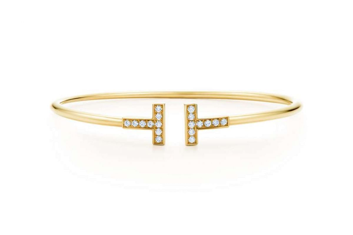 Tiffany & Co's T Wire Bracelet in 18K gold with diamonds. Price in Singapore: $5,000; in the US: around US$3,200 (S$4,596).