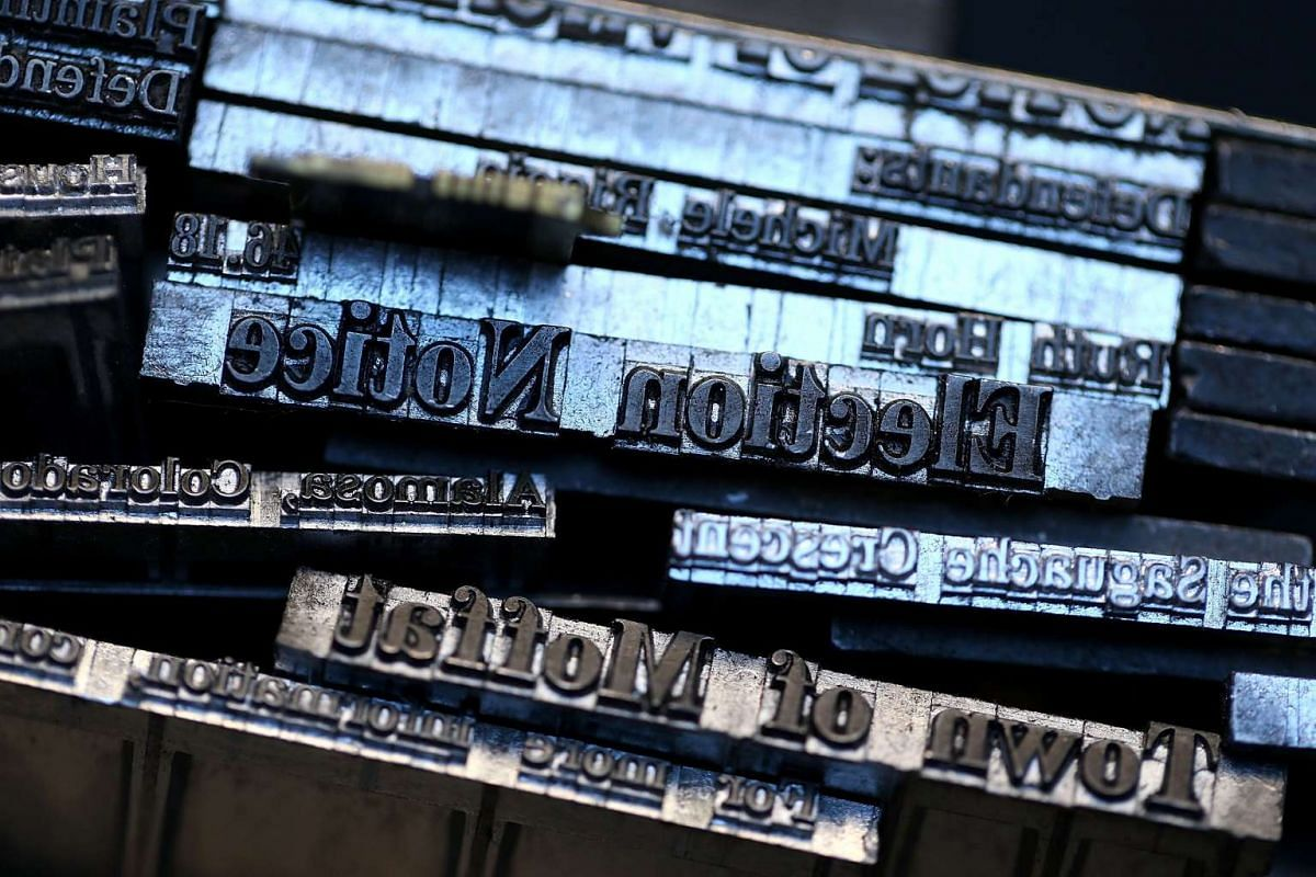 Metal type slugs that were created using a Linotype hot metal typesetting maching sit on a shelf inside the offices of the Saguache Crescent newspaper.