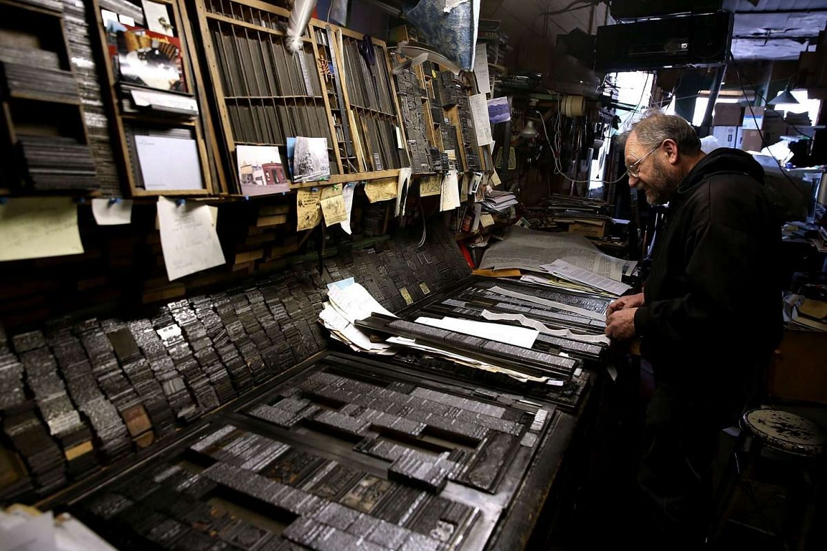 Saguache Crescent owner and editor Dean Coombs lays out blocks of metal type slugs that were created using a vintage hot metal Linotype typesetting machine.
