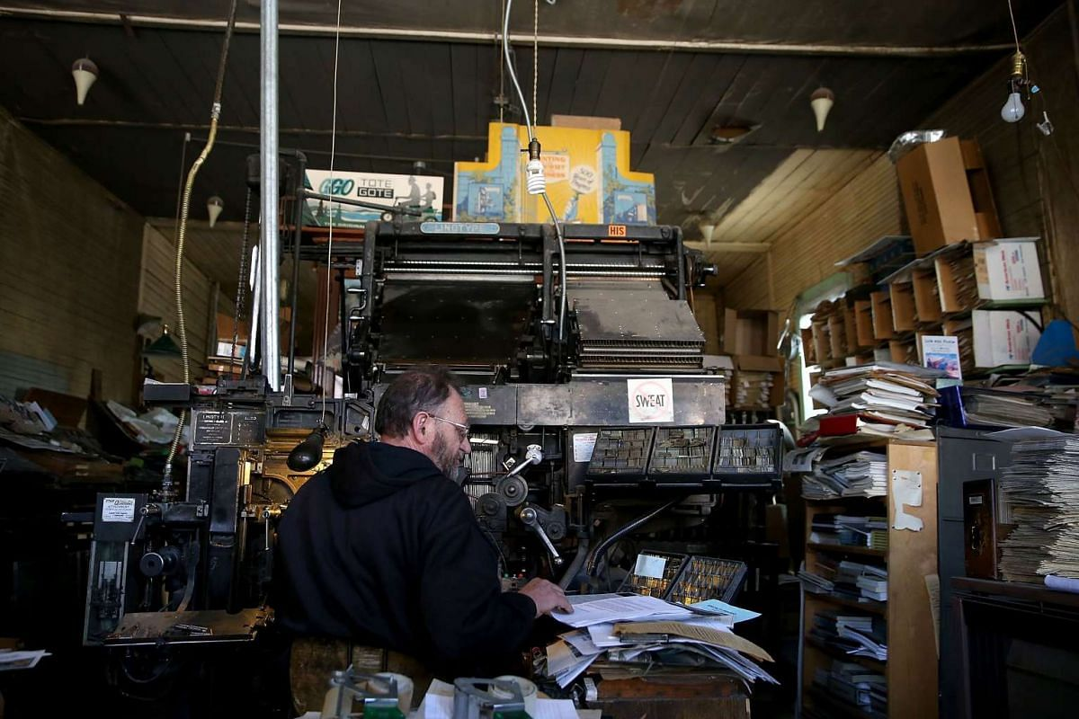 Saguache Crescent owner and editor Dean Coombs enters text into a vintage hot metal Linotype typesetting machine.