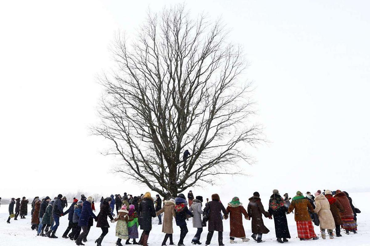 Villagers take part in Kolyada holiday celebrations in the village of Martsiyanauka, Belarus, Jan 21, 2016. PHOTO: REUTERS