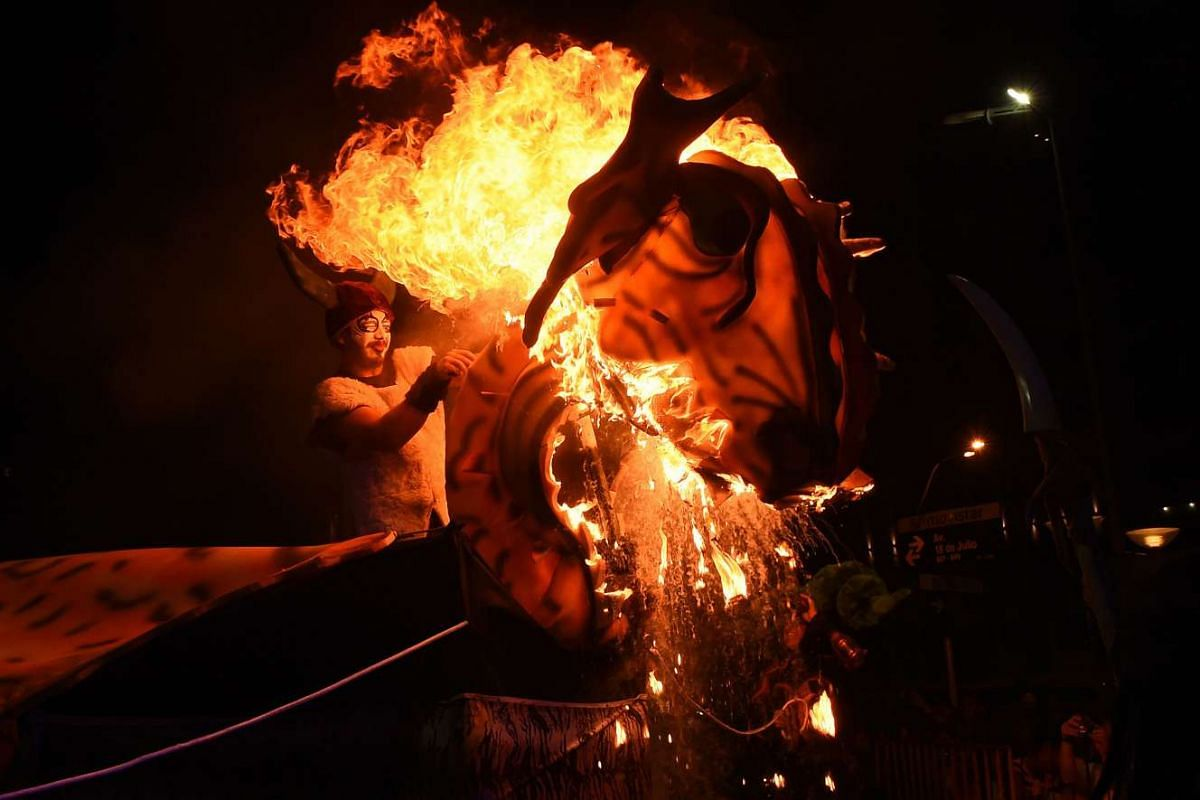 A float catches fire by accident during the opening parade of the Uruguayan carnival --the world longest-- in Montevideo, on Jan 21, 2016. PHOTO: AFP