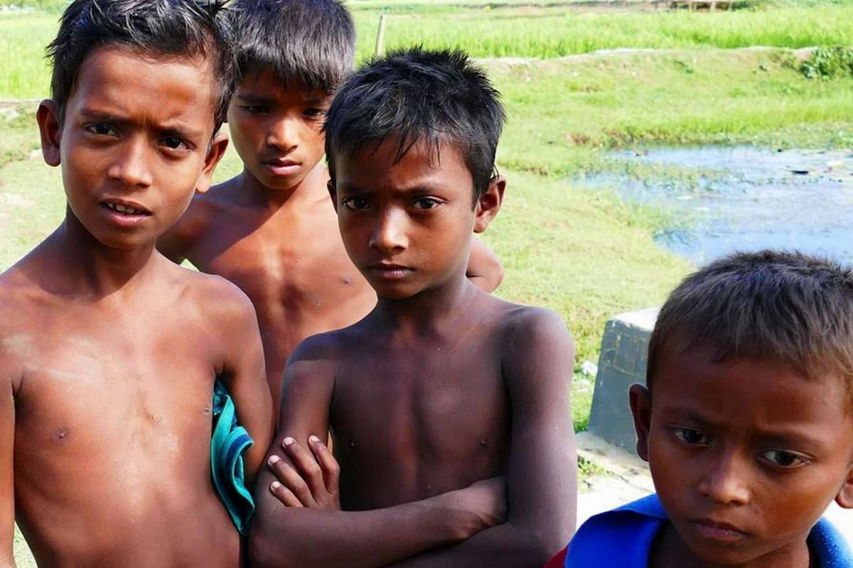 A crowd of children gather in a village in Rakhine state, Myanmar. Most of the youth in this region find hope by fleeing abroad.