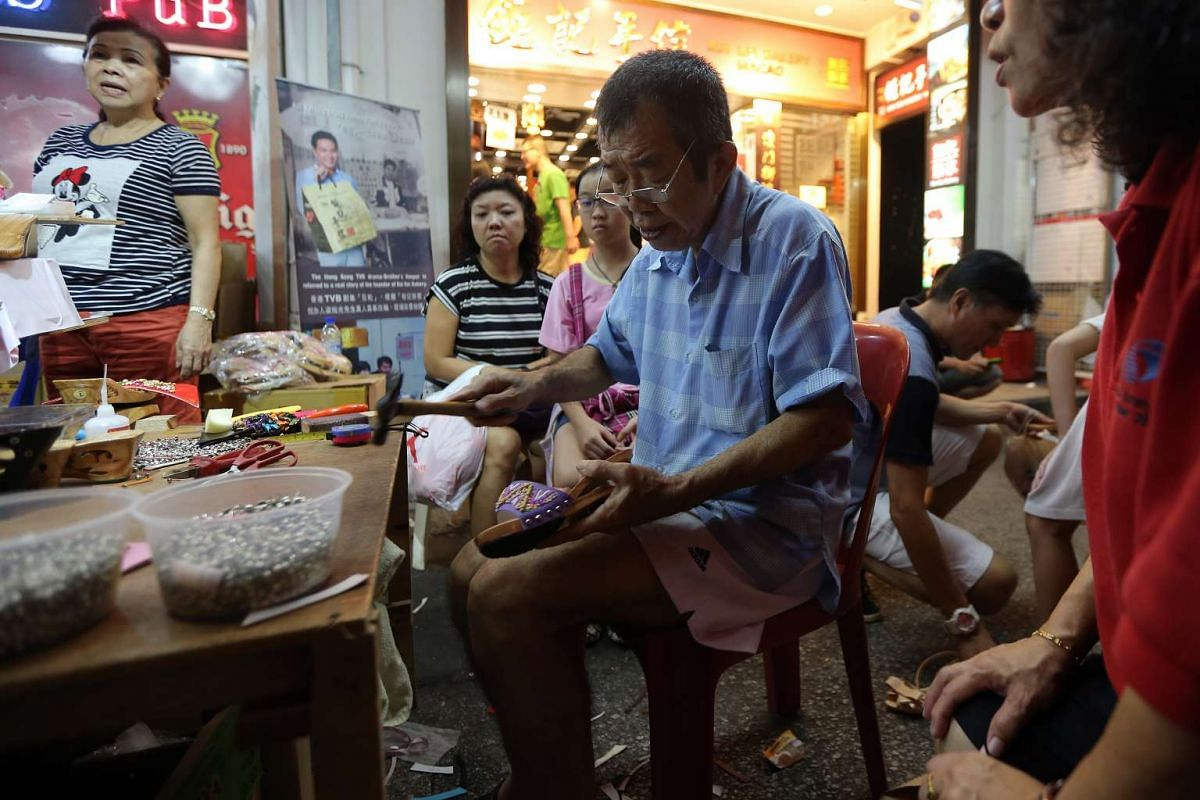 Shoemaker Michael Tay, 66, has set up shop at the Festive Street Bazaar for nearly 10 years.