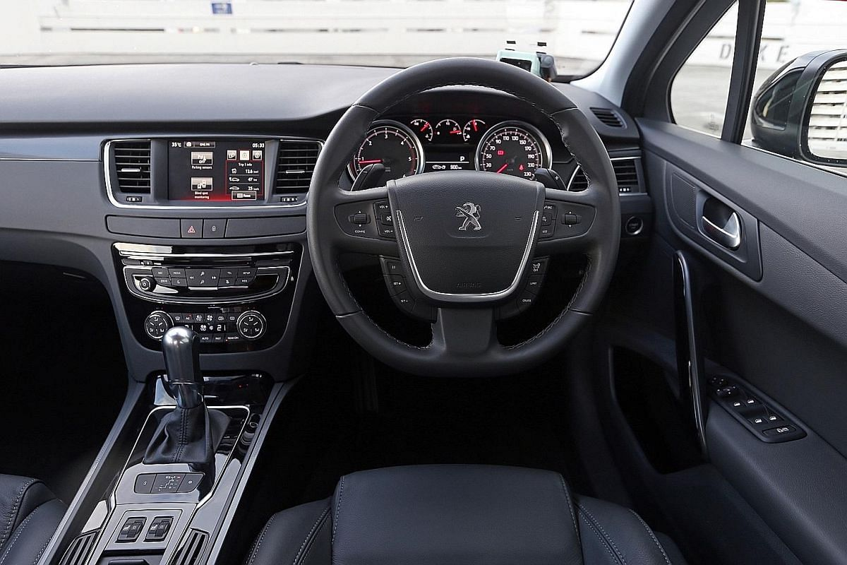There are a dizzying 14 buttons on the steering wheel of the new Peugeot 508.