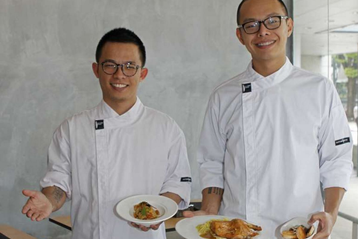 Saveur co-owners Dylan Ong (left) and Joshua Khoo with pasta served with caviar and crispy ebi and oven-roasted half chicken with buttery Savoy cabbage.