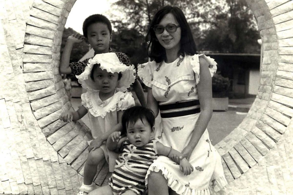 My life so far: Madam Soon Puay Keow (right), 32, with her three children (from top) Mike, six, Giao Pik, four, and Stephanie, two, at the Chinese Gardens in 1975.