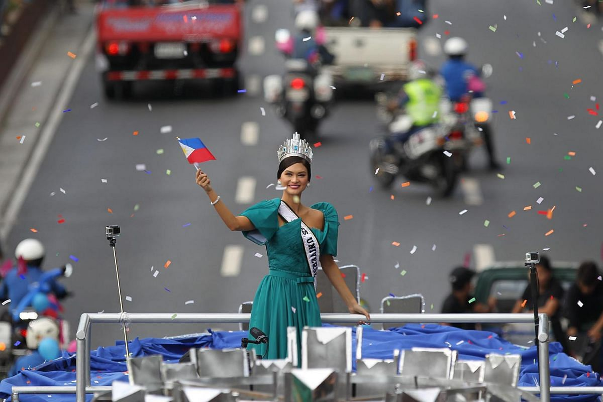 Ms Pia Wurtzbach waving to the crowd during her homecoming parade in Manila, Philippines, on Jan 25, 2016.