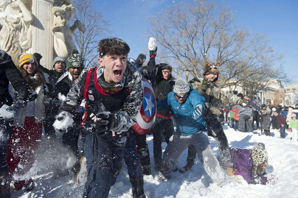 People participate in a snowball fight after the weekend's blizzard, at Dupont Circle in Washington DC on Jan 24, 2016. More than 4,400 flights were cancelled as the mega-storm ground airports in New York, Philadelphia, Washington and Baltimore to a