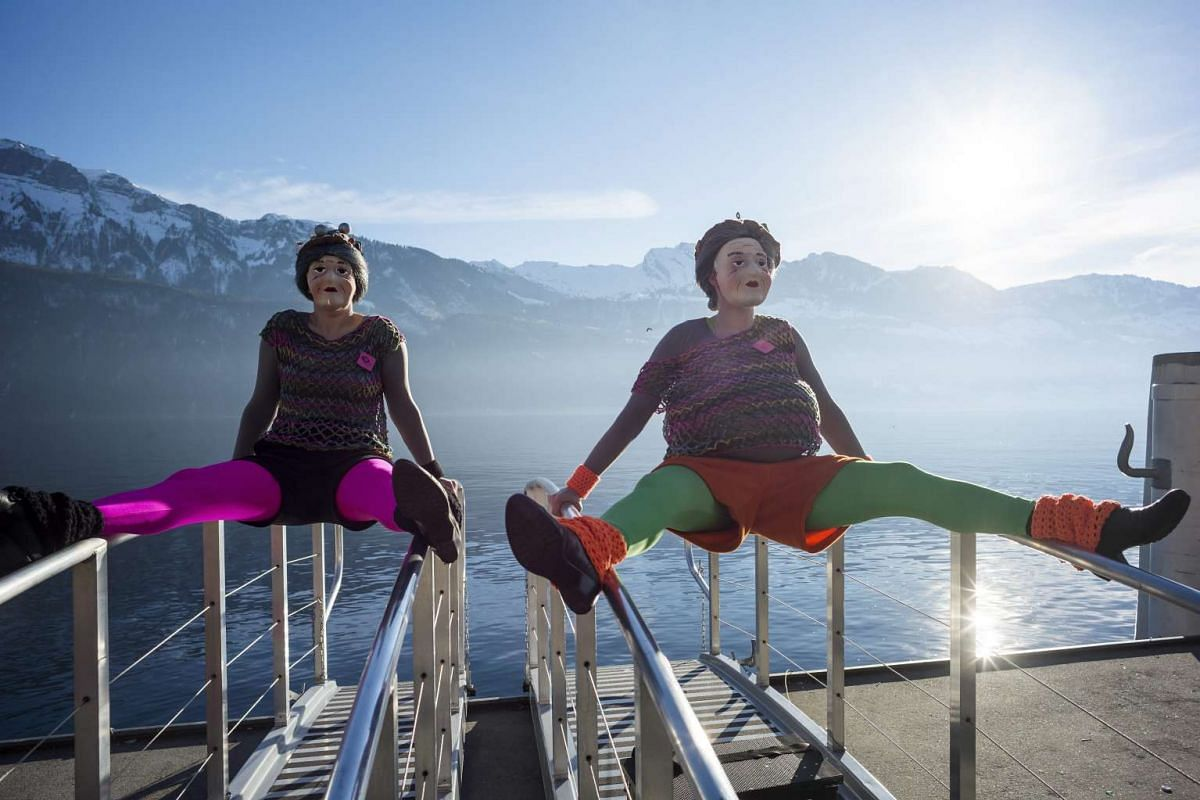 Women in costumes perform a gymnastic exercise on the first day of the Gersau Fasncht in Switzerland on Jan 25, 2016.