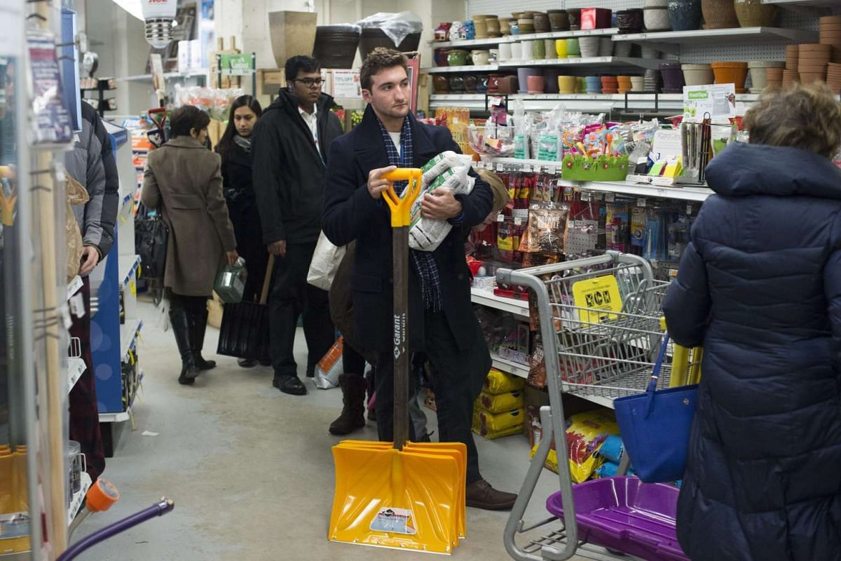 A customer waits in a line to purchase shovels and ice melt, as shoppers prepare for an approaching snowstorm in Washington DC on Jan 21, 2016.