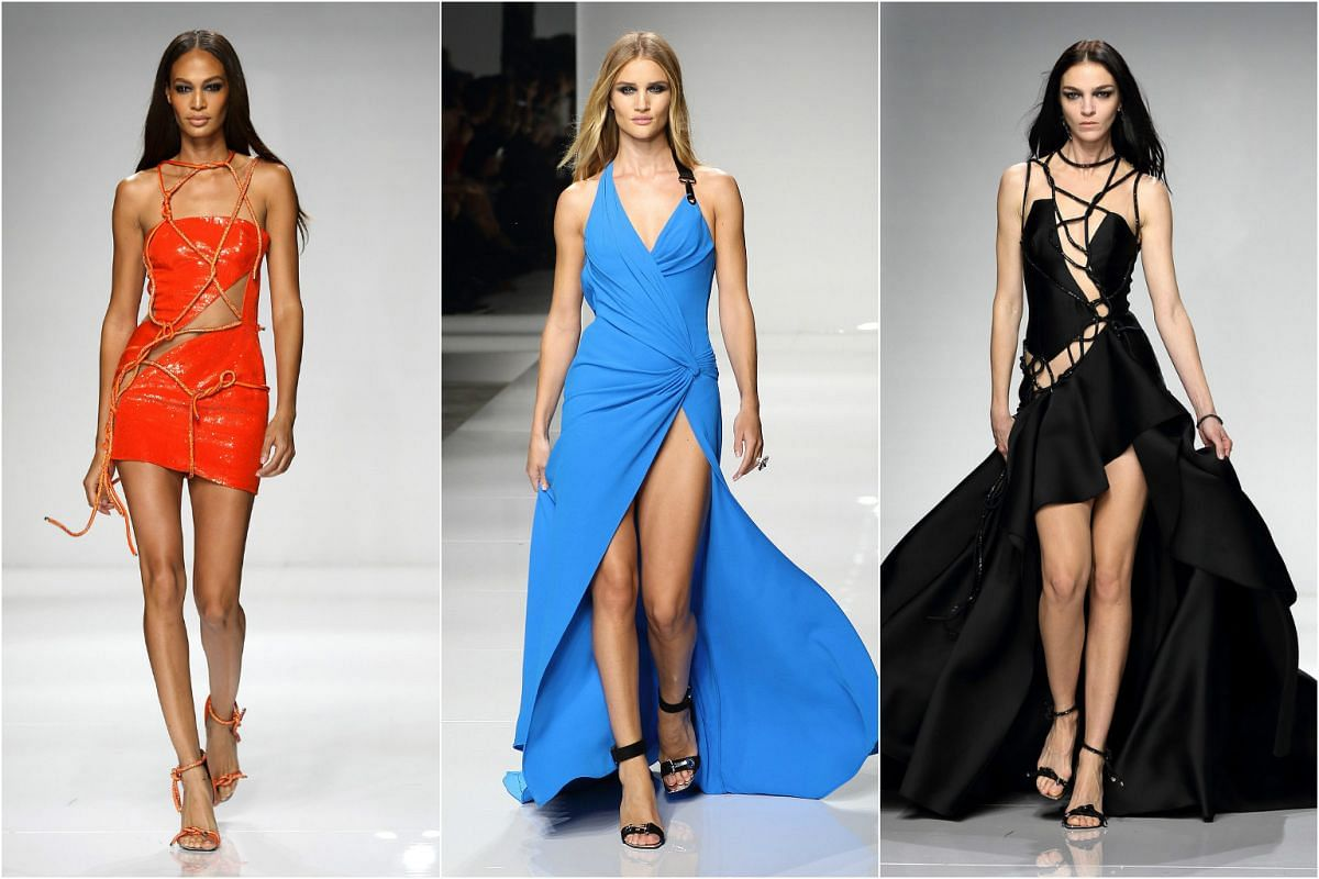 (From left) Models Joan Smalls, Rosie Huntington-Whiteley and Mariacarla Boscono presenting creations from the Spring/Summer 2016 Haute Couture collection by Italian designer Donatella Versace for Atelier Versace during Paris Fashion Week.