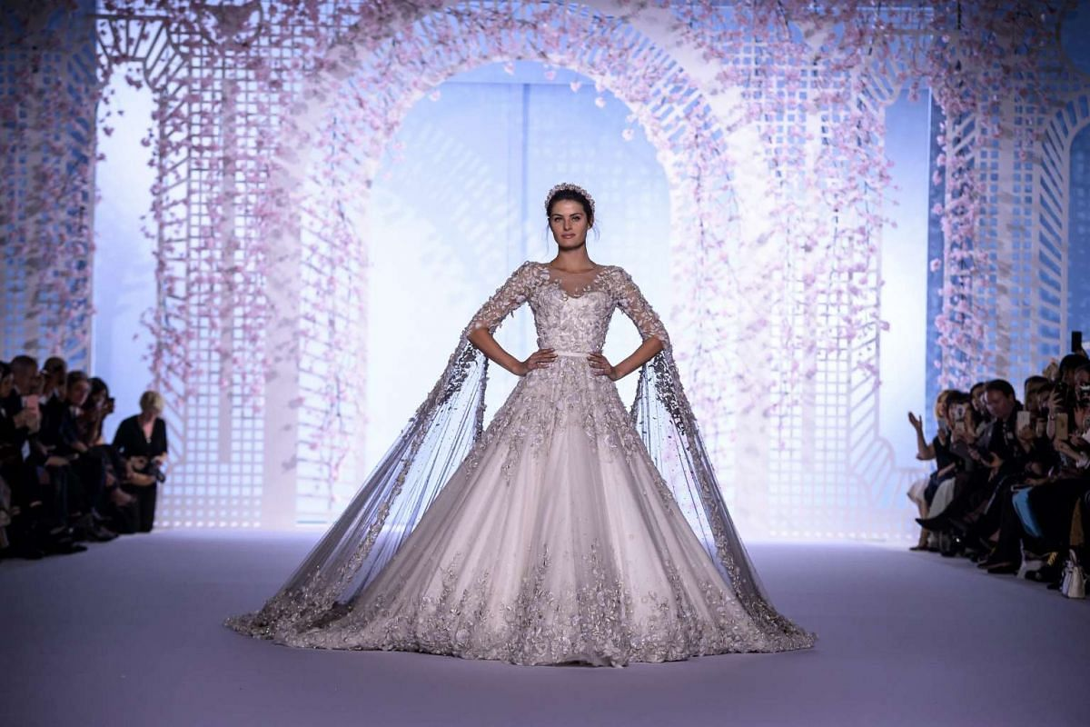 Brazilian model Isabeli Fontana presenting a creation from the Spring/Summer 2016 Haute Couture collection by Tamara Ralph and Michael Russo for Ralph and Russo during Paris Fashion Week in Paris, France, on Jan 25, 2016.