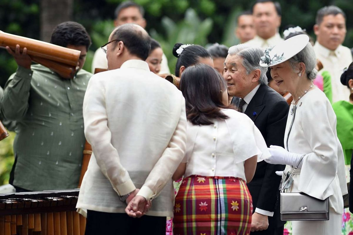 Emperor Akihito (second from right), his wife Empress Michiko (right) and Philippine President Benigno Aquino (left, back to camera) listen to a bamboo orchestra during a welcoming ceremony at the Malacanang Palace in Manila on Jan 27.