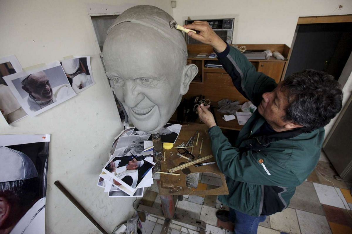 Sculptor Pedro Francisco Rodriguez working on a mold of Pope Francis' head in Ciudad Juarez on Jan 25. The bronze statue will measure over 4.9m to mark the Pope's visit to Ciudad Juarez in February.