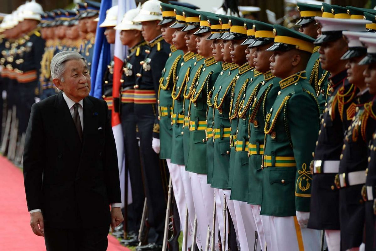 Japan's Emperor Akihito (left) reviewing an honour guard during a welcome ceremony at the Malacanang Palace in Manila on Jan 27.