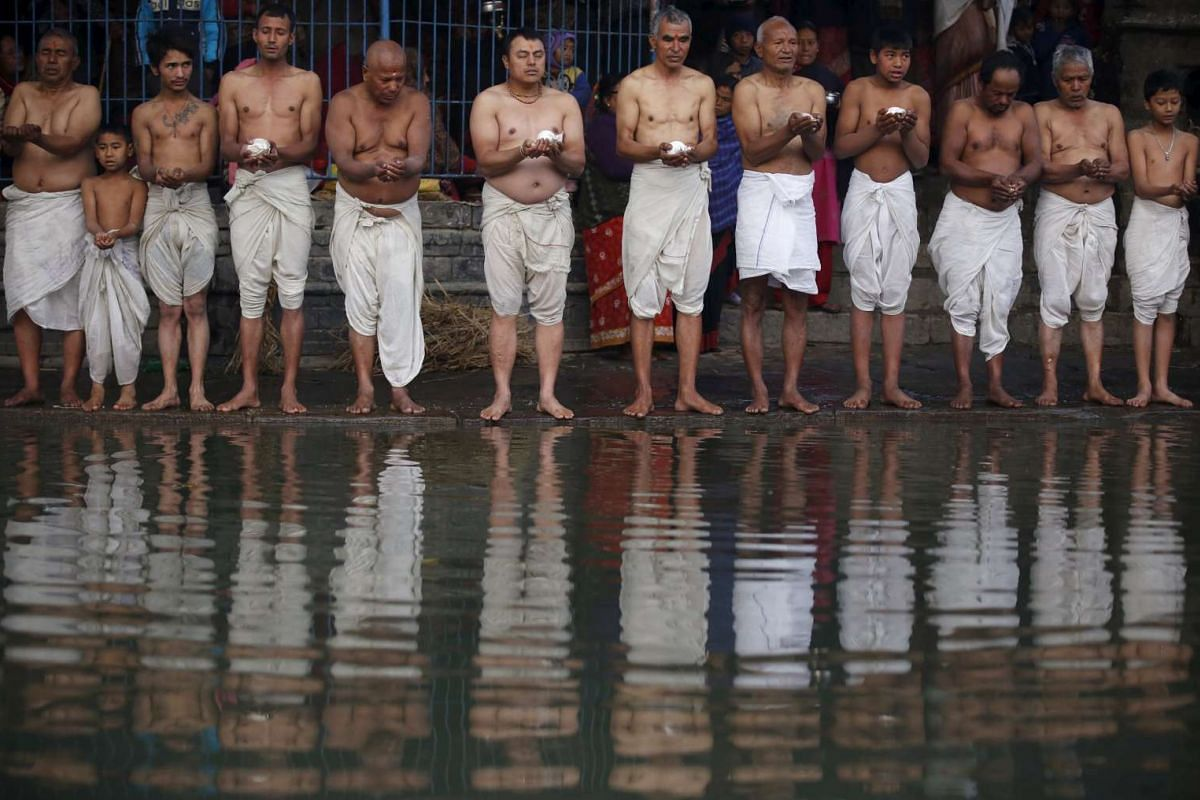 Devotees praying on the bank of the Hanumante River during a month-long Swasthani Brata Katha festival in Bhaktapur, Nepal, on Jan 27.