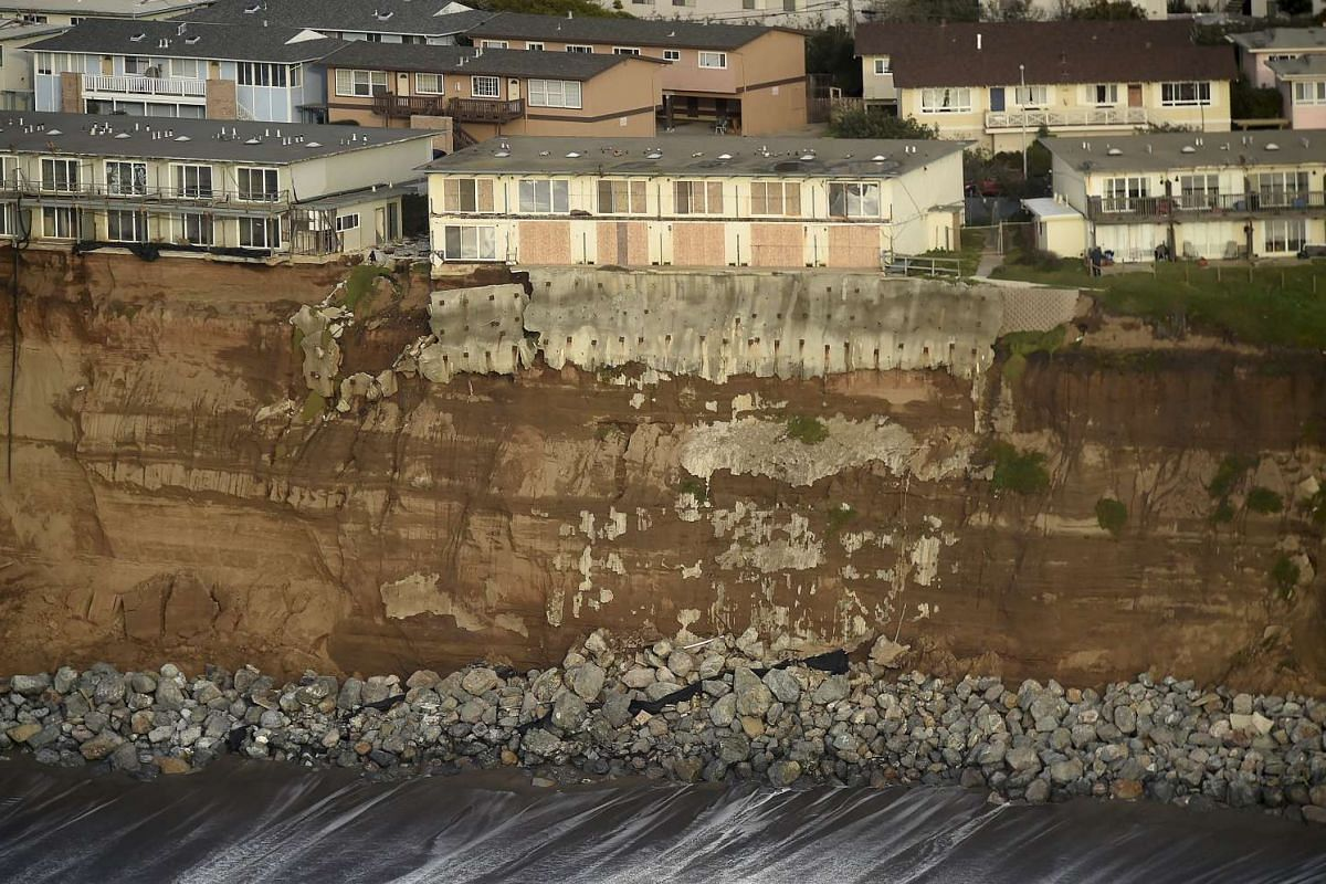 Uninhabitable apartments, in danger of collapsing into the Pacific Ocean, lining Esplanade Avenue in Pacifica, California, on Jan 26. The city has marked three apartment complexes uninhabitable as El Nino storm erosion eats away at the coastal bluff