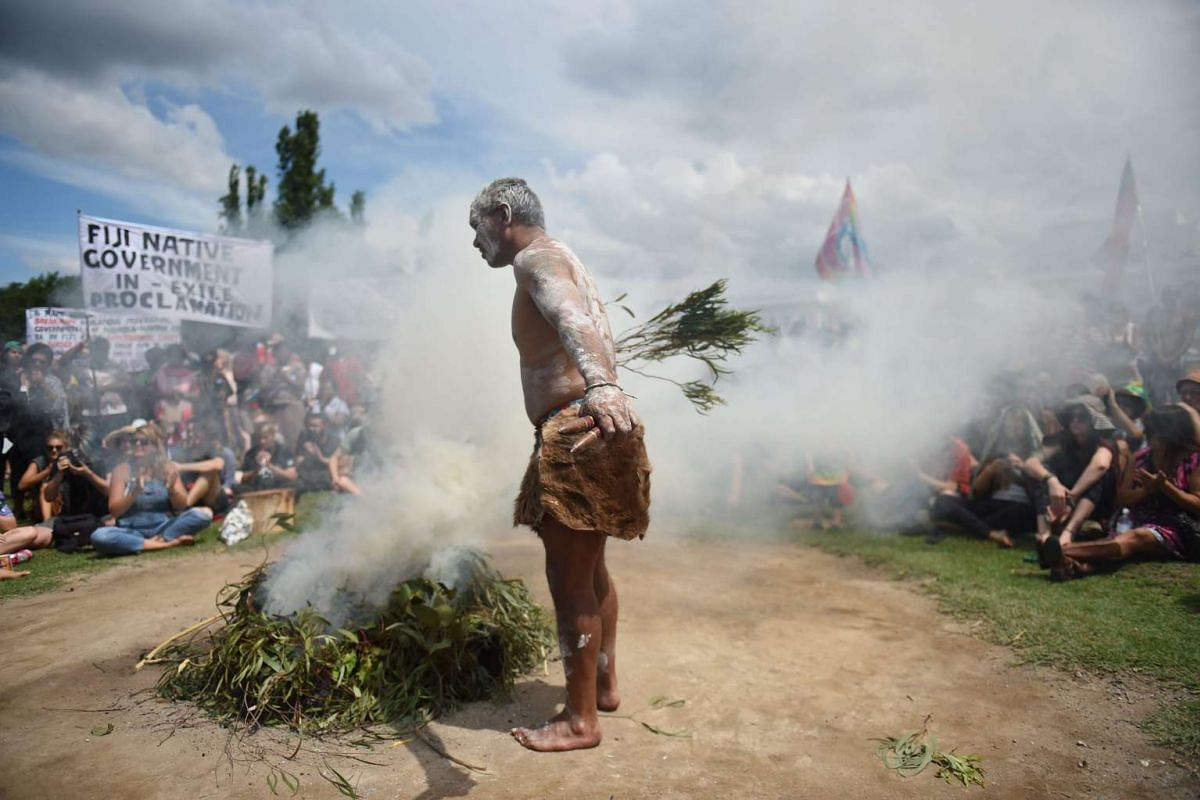 A smoking ceremony is conducted during an Aboriginal protest at the Tent Embassy on the lawns of Old Parliament House in Canberra, Australia, on Jan 26.