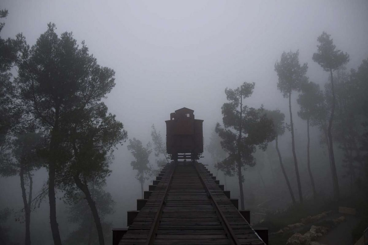A German train box car that was used to transport Jews to concentration camps during World War II is seen on a foggy day at the Yad Vashem Holocaust Memorial Museum in Jerusalem on Jan 26.