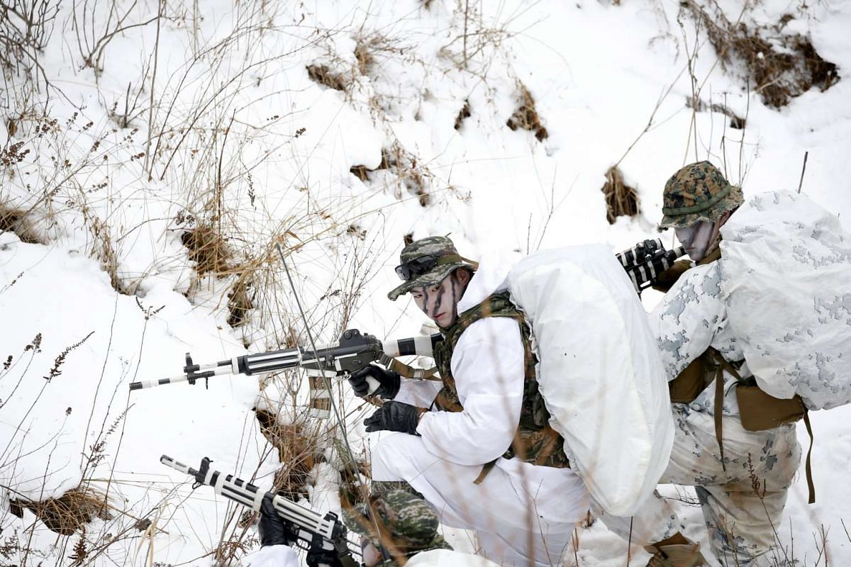 South Korean and US Marines participate in a winter military drill in PyeongChang, South Korea, on Jan 28, 2016.