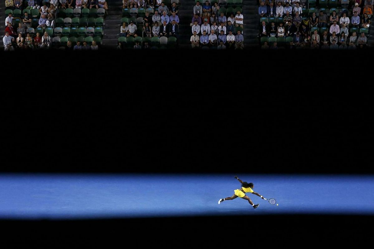 Serena Williams of the US stretches for a shot during her semi-final match against Poland's Agnieszka Radwanska at the Australian Open tennis tournament at Melbourne Park, Australia, on Jan 28, 2016.