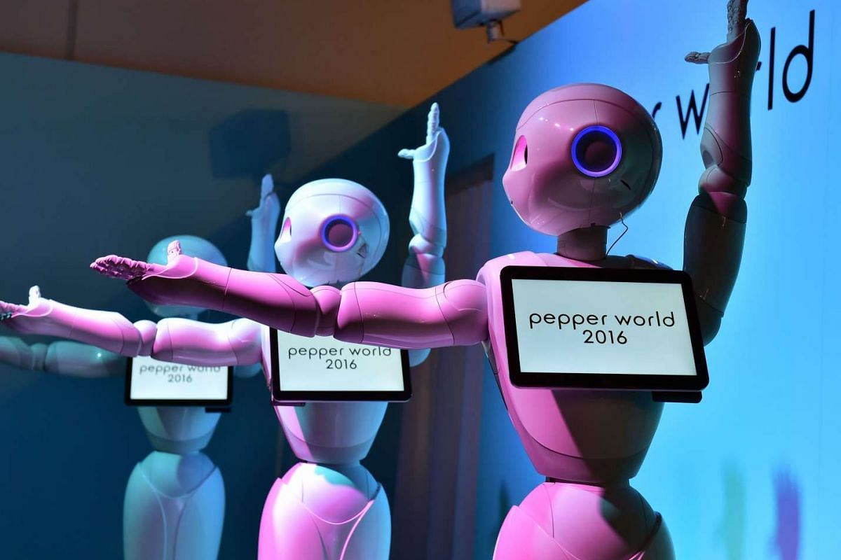 Pepper, humanoid robots from Japan's telecommunication giant Softbank, dance to attract customers at the Pepper World exhibition to promote show applications for corporate use in Tokyo on Jan 28, 2016.
