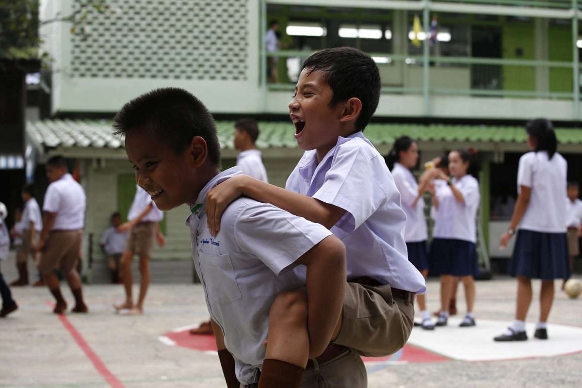 Schoolchildren playing in the courtyard of the Wannawit School in central Bangkok, Thailand.
