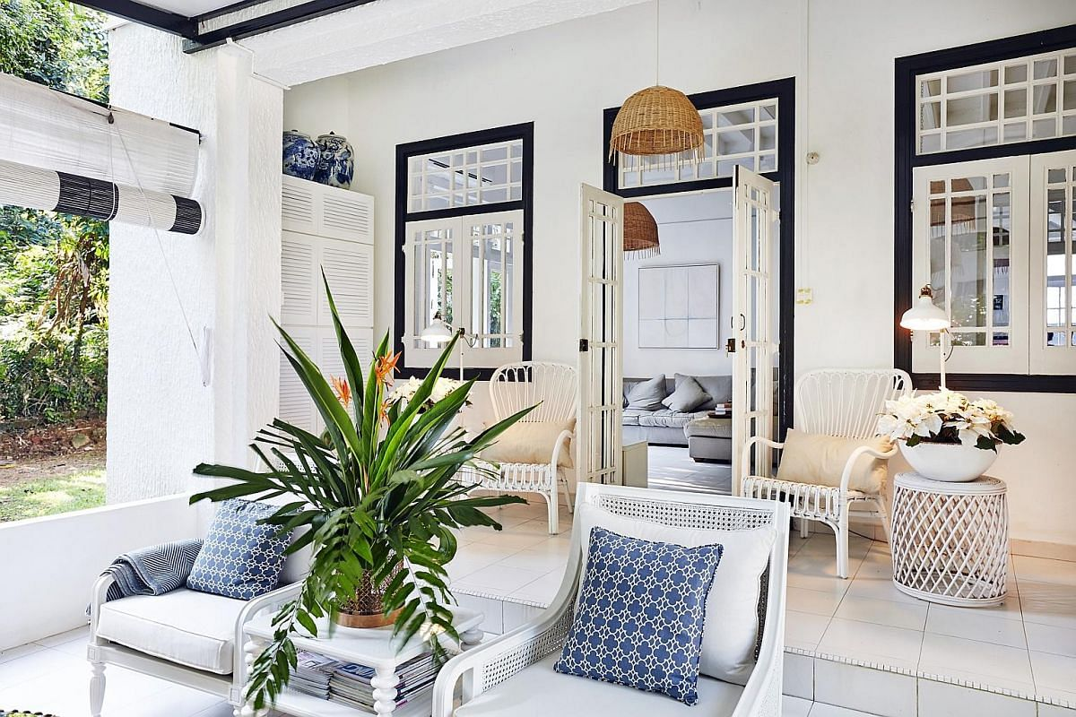 Real-estate agent Lawrence Poh lugs suitcases of cutlery, throw pillows and potted plants to stage homes such as this one (above). Cushions (above) add texture to a sofa (left) in this staged space. Create a picture-perfect and cosy home environment