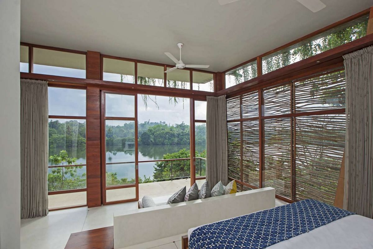 A villa (above) at eco-resort Tri, which is nestled on the shores of Lake Koggala in Sri Lanka.