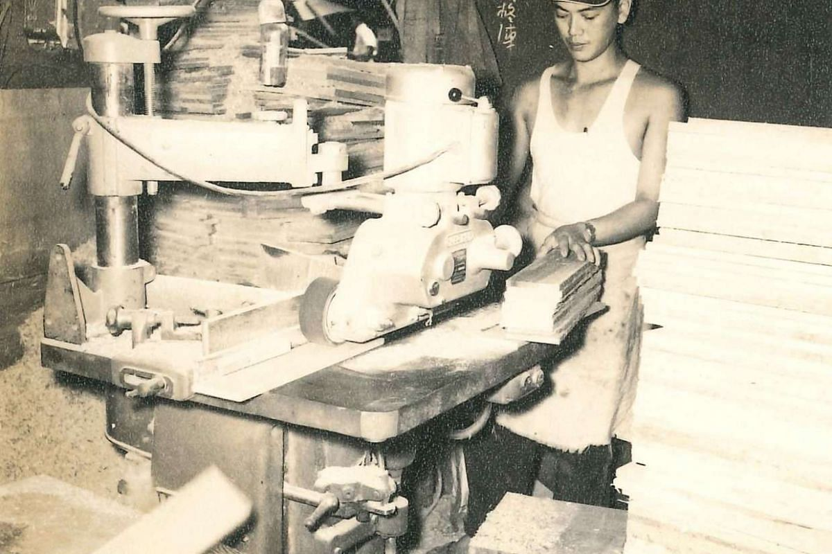 A worker operating machinery at the sawmill in the 1950s.