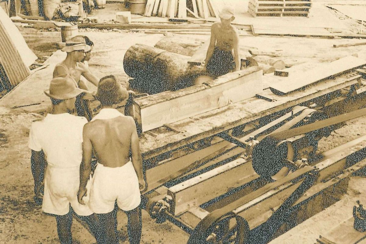 Workers cutting timber planks at the sawmill in the 1950s.