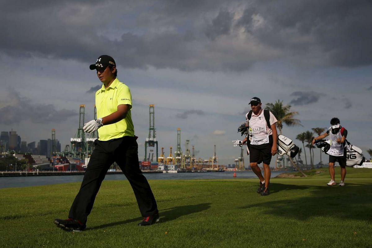 Shintaro Kobayashi of Japan walks down the seventh green during the third round of the SMBC Singapore Open golf tournament at Sentosa's Serapong golf course in Singapore on Jan 30, 2016.