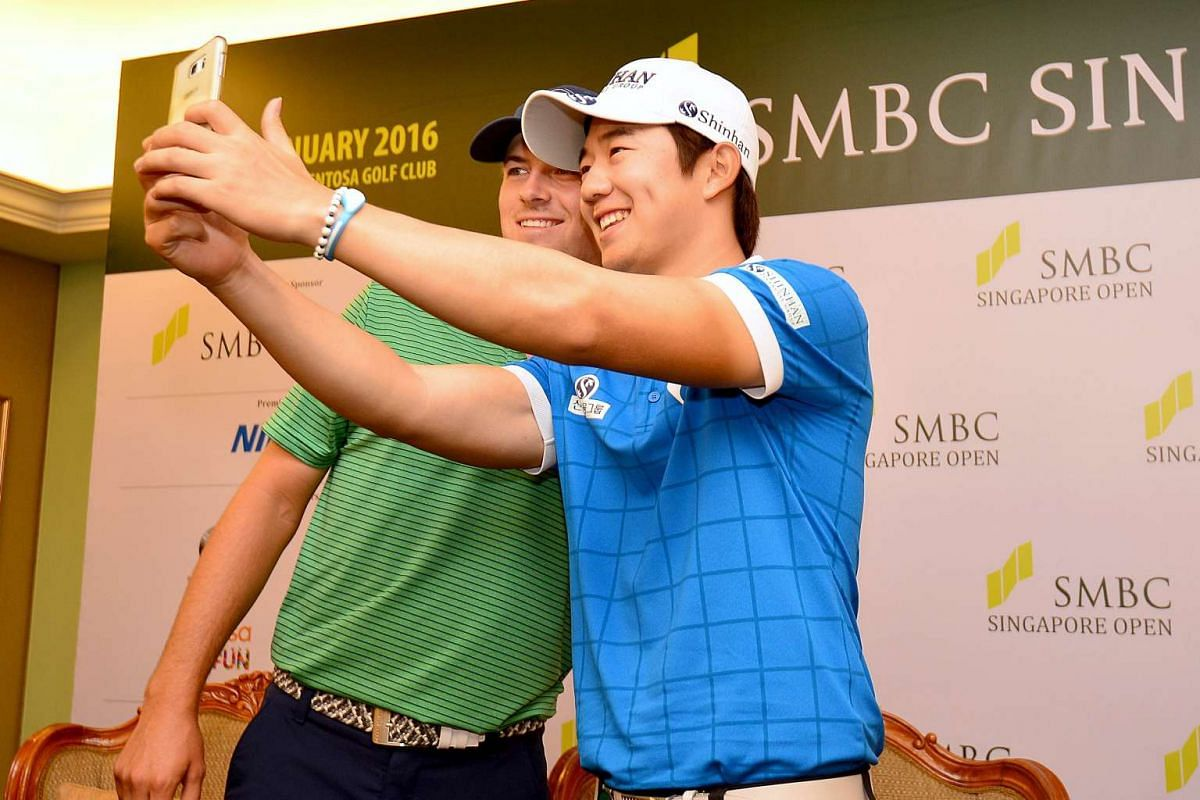 SMBC Singapore Open champion Song Young Han gets his second prize of the week, a wefie with world No. 1 Jordan Spieth, who finished second behind Song.