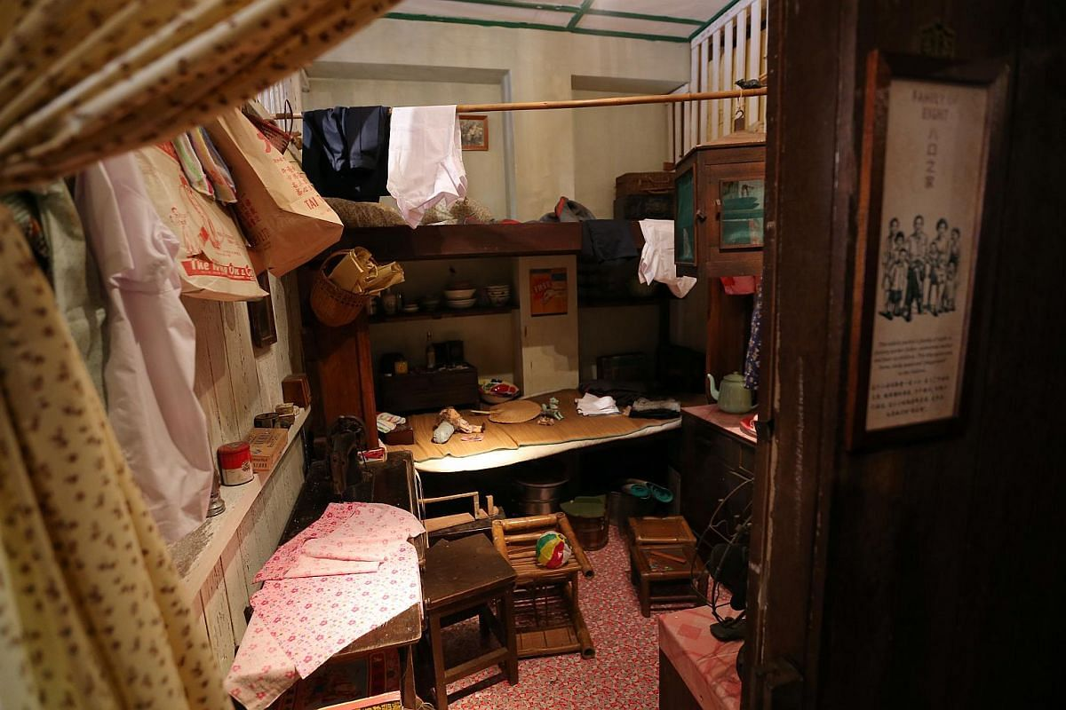 A Family of Eight - The former Painter's Cubicle that gave a glimpse of a typical family life in the shophouse is updated to feature a different family - the Kong family who used to live at 48 Pagoda Street.
